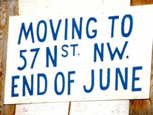 Sign showing a move to a new location